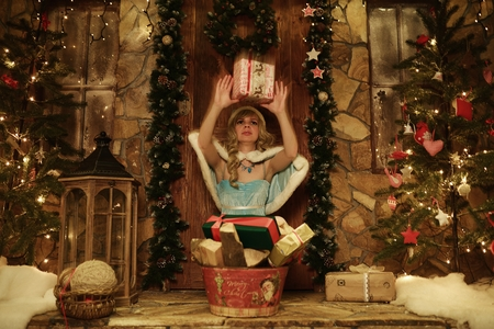 snegurochka: Snow Maiden throw present. Doorstep of house decorated in Christmas style