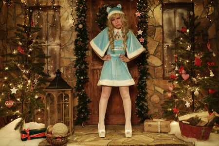 doorstep: Snow Maiden on doorstep of house decorated in Christmas style