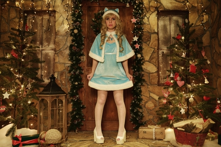 maiden: Snow Maiden on doorstep of house decorated in Christmas style