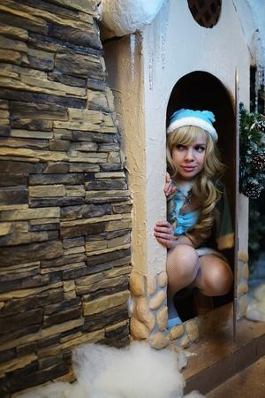 maiden: Beautiful Snow Maiden in studio Christmas interior