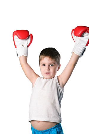 Little boy with red boxing gloves victory posing on white background isolated Stock Photo