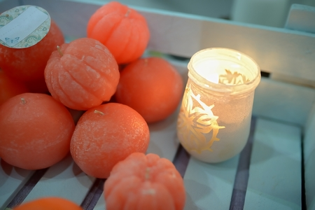 Tangerines on a wooden rustic background with candle