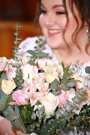 Bride with flowers on the wedding day Stock Photo