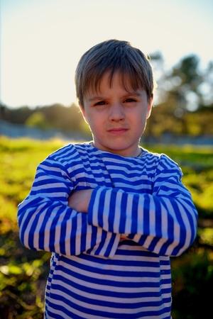 Portrait of dirty little boy in village photo