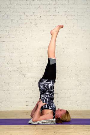 dhanurasana: Adult woman practicing yoga