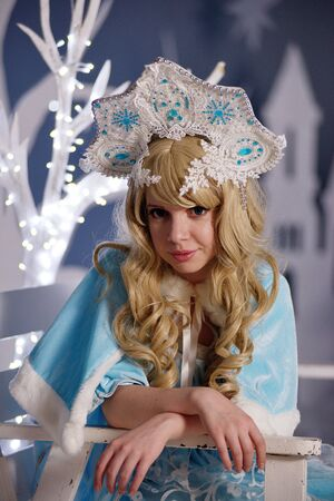 Russian Snow Maiden in blue suit and kokoshnik