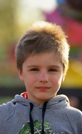 Closeup portrait of cute boy in park Фото со стока