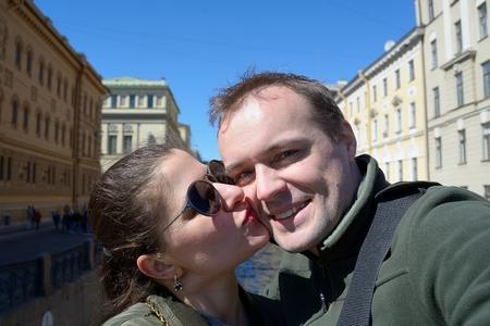 Portrait of happy couple on streets of St. Petersburg Фото со стока