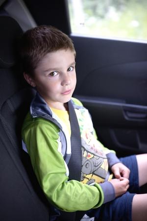 Boy sitting in car safety chair