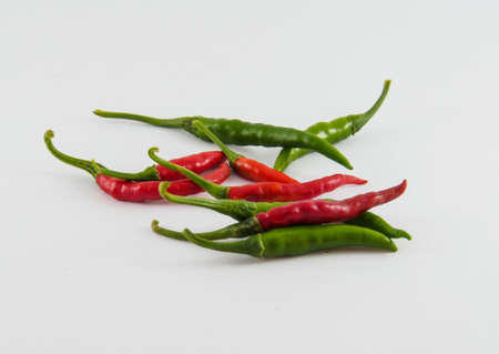 capsaicin: Red chilli and green chilli on white background