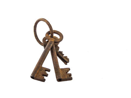 key success: The old rusty key of white background.