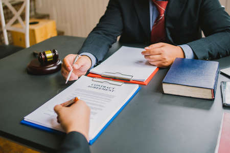 business people and lawyers discussing contract papers.Legal planning. Concepts of law, advice, legal services. Stock fotó