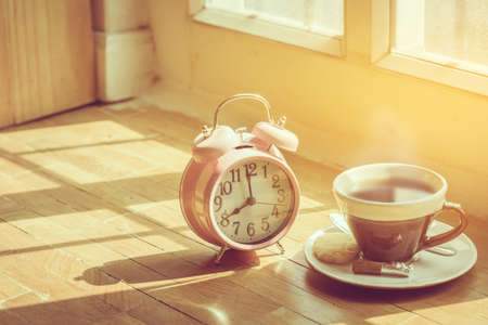 Coffee morning and alarm clock close up  in the morning sunlight,Good morning