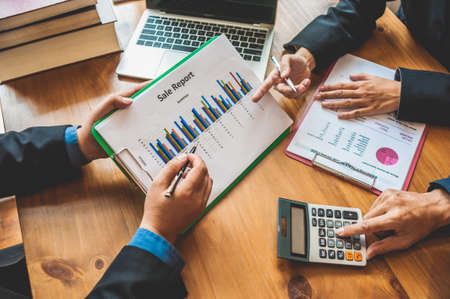 Business Analysis and Strategy. Businessman work with calculator on table in office work with paper graph chart business marketing plan analysis 免版税图像