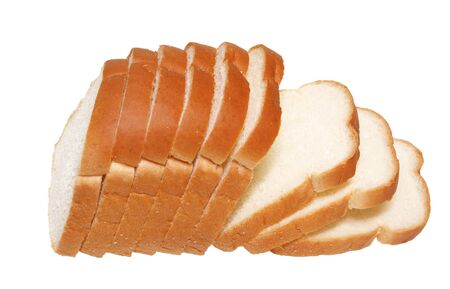 Cut loafs of bread isolated on white background