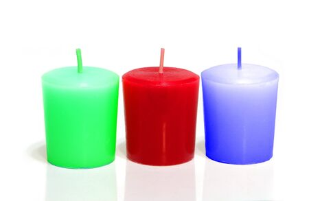 Three colored candles isolated on white background photo