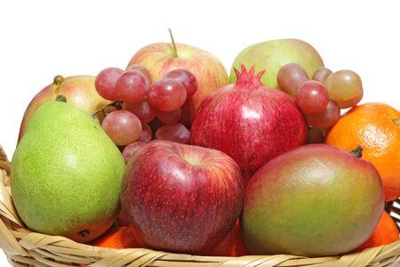 Basket of fruits isolated on white background photo
