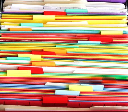 Colorful file folder in the drawer for asbtrast background