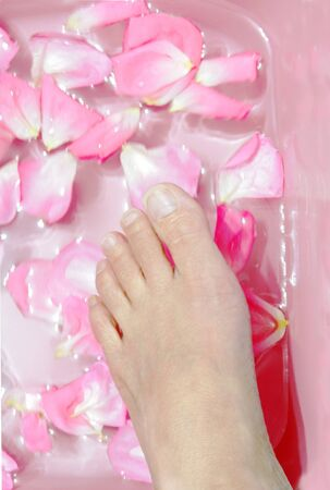 foot in a bowl for beauty treatment Stock Photo