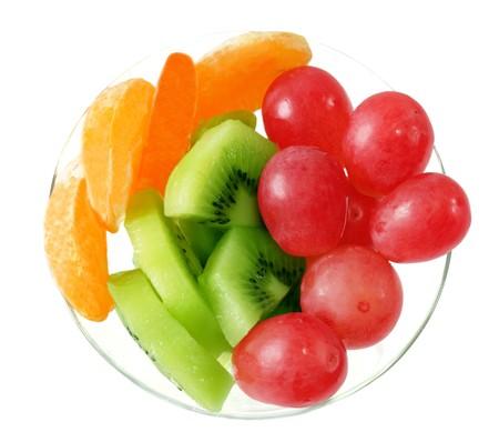 Fresh fruit on plate isolated on white Reklamní fotografie