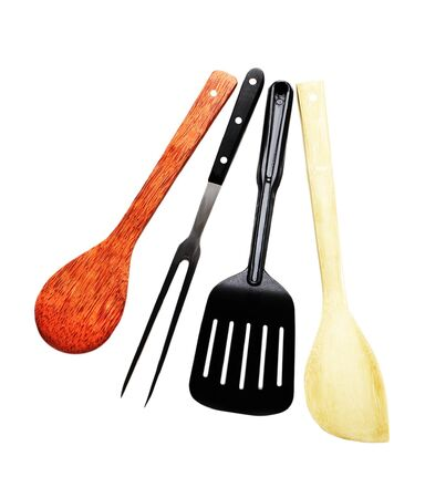 Four pieces of kitchen utensils made from bamboo, coconut tree, plastic, and metal photo