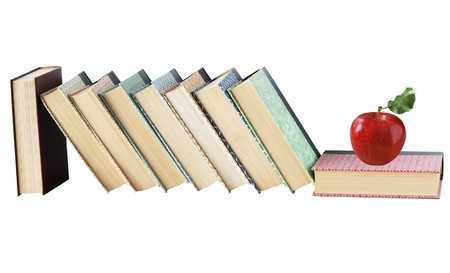 Old books and fresh red apple isolated on white background Zdjęcie Seryjne