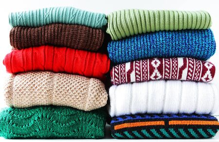 messy clothes: Two stacks of sweaters