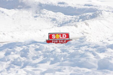 snow ground: For Sale sign, sold, on snow ground Stock Photo