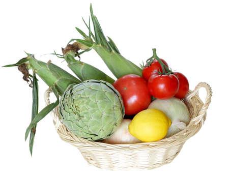 Basket of vegetable isolated on white background photo