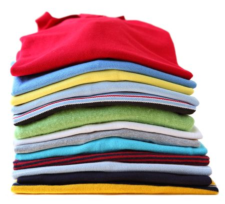 Pile of colorful ironed shirts isolated on white