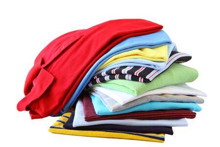 clothes washing: Pila de camisetas en diferentes colores aislados en blanco Foto de archivo