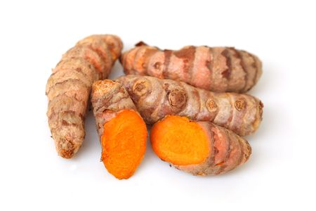 tumeric: Group of turmeric roots isolated on white background