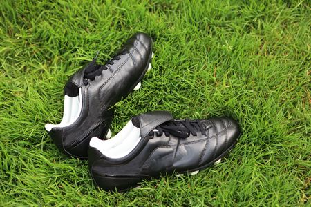 Pair of soccer shoes on grass field Stock Photo - 5317920