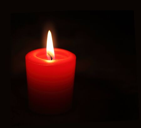 Red candle light isolated on white background photo
