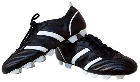 Pair Black leather soccer shoes isolated on white