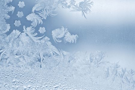 Real beautiful snowflake on the window glass photo