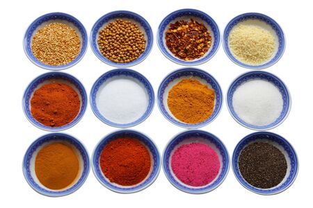glutamate: Variety of colorful spices in nine bowls   Stock Photo