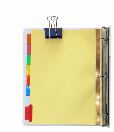 manila: Paper divider with colorful tabs on three ring binder Stock Photo