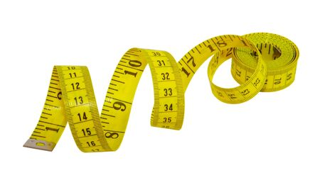 Yellow measuring tape for tailor isolated on white photo