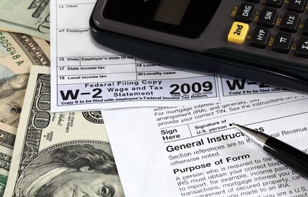 federal tax return: W-2 and W-9 Forms on US dollars  Stock Photo