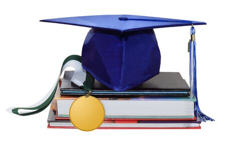 Cap graduation with medal, diploma and books Stock Photo - 6390120