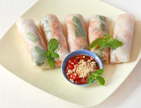 Vegetable spring rolls on the dish with chili soy sauce photo