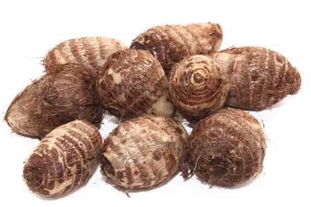 starchy food: Group of taro root potatoes isolated on white