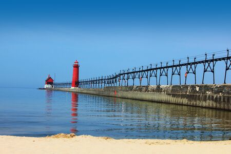summer time: Lighthouse and Pier Grand Heaven Michigan in the summer time Stock Photo