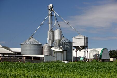 storage compartment: Processing Facility with multiple grain Silos on a Farm