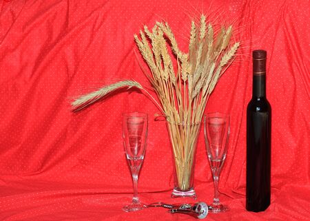 beardless: Wine and several kind of wheat over red background for holiday spirit