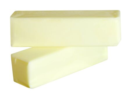 butterfat: Two butter sticks isolated over white background