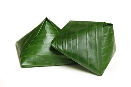 Steamed Vietnamese Rice and Pork Pyramid Dumplings wrapped by banana leaf