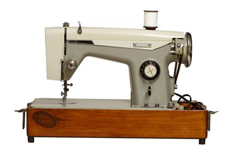 Old sewing machine isolated on white background Stock Photo - 8736001