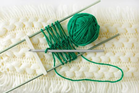 Handmade of cashmere scarf patten with green yarn ball photo
